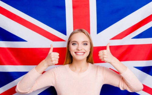 british flag and smiling girl thumbs up